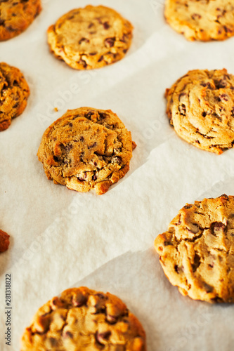 Warm chocolate chip cookies on parchment paper