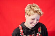 Laughing Blondie With Septum Over Red Background.