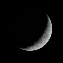 The Crescent Moon In The Night Sky.