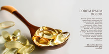 Yellow Gelatin Capsules With A  Drug Omega-3, In A Wooden Spoon, On A White  Background. Alternative Treatment, Beneficial Body Support Fatty Acids For Good Health