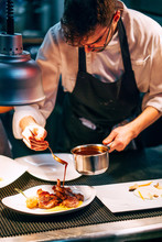 Professional Chef Pouring Sauc...