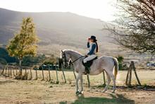 Woman Ridding On White Horse I...