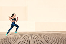 Running Woman On Wooden Walkway