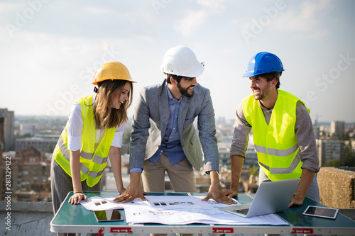 Group of engineers, architects, business partners at construction site working together - 281329422