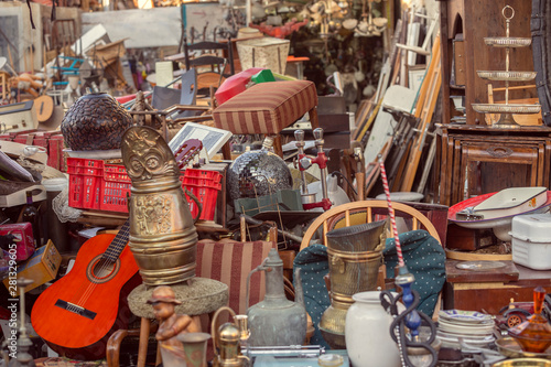 Photo  Old vintage objects and antiques for sale at the flea market