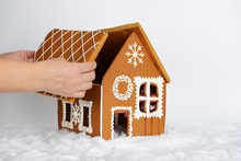 The Hand-made Eatable Gingerbread House, Adding By Hand Of Part Of Roof And Snow Decoration