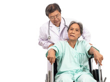 Asian Elderly Woman With A Paralysis, Stroke Or Cerebrovascular Accident (CVA) Symtoms Sitting On Wheelchair And The Doctor Take Care. Elderly Health Care.