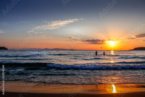 Photo Sunset in Astir Beach - Vougliameni - Athens Greece - kids playing in the ocean