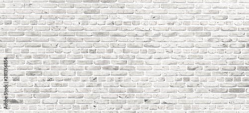 White brick wall. Simple grungy white brick wall with light gray shades pattern surface texture background in wide panorama format. - 281356854