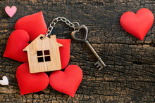 House Key In Heart Shape With Home Keyring On Old Wood Background Decorated With Mini Heart