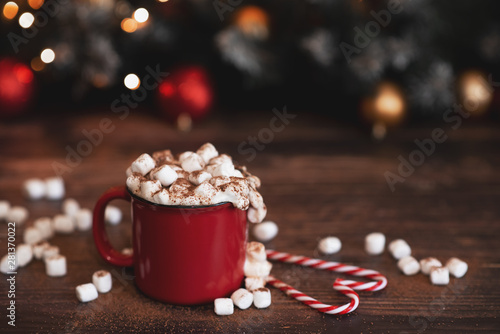 Foto auf Leinwand Schokolade Winter whipped cream hot coffee in a red mug with star shaped cookies and warm scarf - rural still life