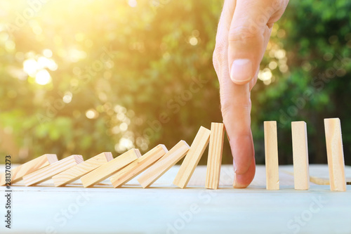 Fotografie, Obraz  image of male hand stopping the domino effect