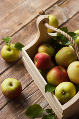Ripe apples in wooden box. Top view with space for your text