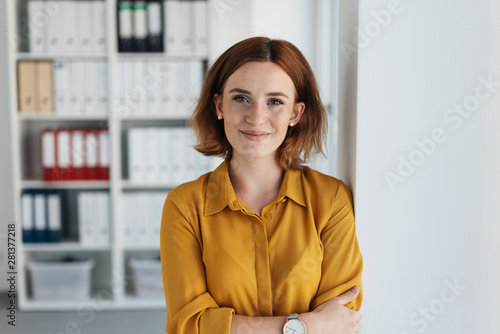 Self-assured relaxed young businesswoman