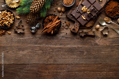 Staande foto Retro Christmas or new year culinary rustic wooden background with food ingredients for cooking festive dishes, xmas baking. Holiday cooking frame for Noel pastry on wooden table