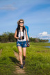 woman traveler standing near the lake background is the mountain and enjoying for beautiful view of nature on holiday.adventure concept.