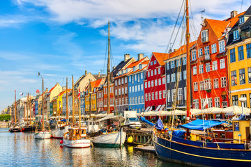 Copenhagen iconic view. Famous old Nyhavn port in the center of Copenhagen, Denmark during summer sunny day