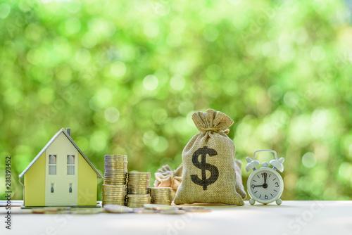 Mortgage-backed security MBS, financial concept : House model, stacks of rising Billede på lærred