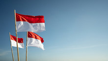 Indonesia Flags Under Blue Sky...
