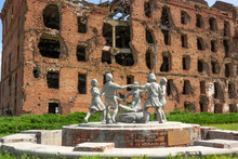 Volgograd/Russia-18.06.2016:The Statue Of With Circle Of Kids And Crocodile And Destroyed Building