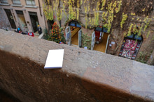 Paper Notebook For Romantic Notes On The Handhold Of A Stone Balcony In The House Of The Legendary Shakespeare's Juliet. Verona, Italy