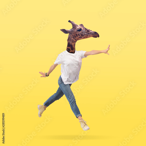 Obraz Female body in jeans and white shirt headed by giraffe head against yellow background. Negative space to insert your text. Modern design. Contemporary art collage. Vacation, summer, resort. - fototapety do salonu