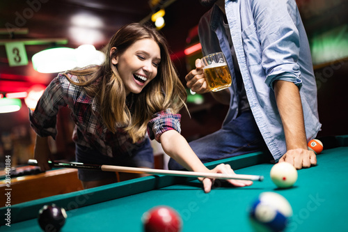 Couple dating, flirting and playing billiard in a pub Fototapet