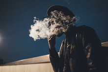 Low Angle View Of Man Smoking ...