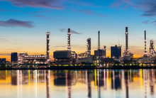 Oil And Gas Refinery Industry Plant With Glitter Lighting And Sunrise In The Morning, Factory Of Petroleum Industrial, Power Plant,Energy Power Station Area. Industry 4.0