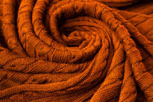 Knitted Blanket In Autumn Colors. Soft And Warm Fabric. Texture For Background Or Illustrations.