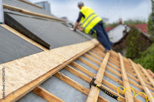 Tela Building construction process of new wooden roof on wood frame house