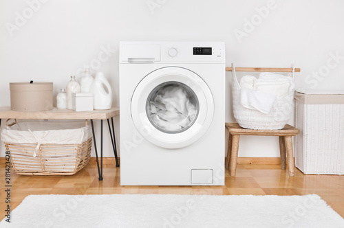 Domestic room interior with modern washing machine and laundry baskets Fototapeta