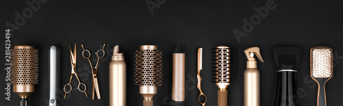 Obraz Collection of professional hair dresser tools arranged on dark background - fototapety do salonu