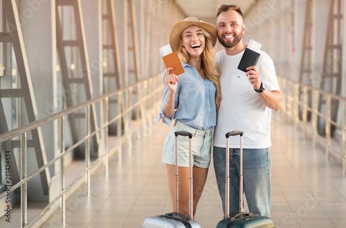 Fotografia  Couple waiting for departure, holding passports, copy space