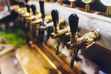 Close Up Of Beer Taps In Row. ...