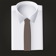 Folded Shirt With Tie Against A Dark Background