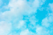 canvas print picture - Vibrant clear blue sky with puffy clouds, an abstract background