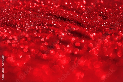 Fotografía  red shining golden sand made of glitters - celebratory concept with bokeh textur