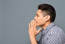 Young Man Praying And Asking F...