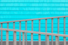Turquoise Wall And Grey Fence