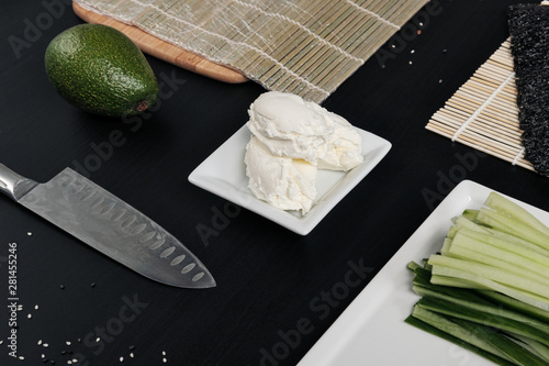 Fotografía  Ingredients for sushi and rolls. Red fish, avocado, cream cheese.