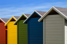 Colorful Changing Locker Huts At The Beach In Germany. Summer Vacation At The Beach Concept.