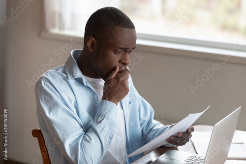 African guy holding letter reading shocking unexpected news feels disappointed Canvas Print