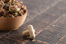 Dried Red Clover Flowers And Leaves On A Wooden Table