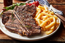 Tasty Grilled T-bone Steak Sea...