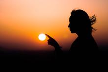 Woman Holding The Sun