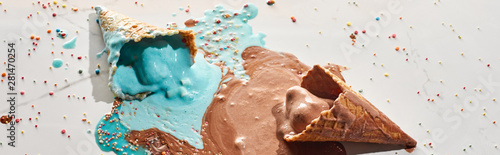 delicious melted chocolate and blue ice cream in waffle cones on marble grey bac Wallpaper Mural