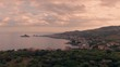 Aerial pull out view of the fishing villages of Capo Mulini and Aci Trezza in Sicily at sunset