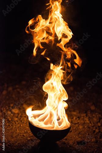 Foto op Canvas Kruiderij Outdoor fire against a night dard background