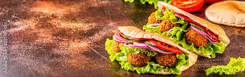 Falafel and fresh vegetables in pita bread. - 281487684